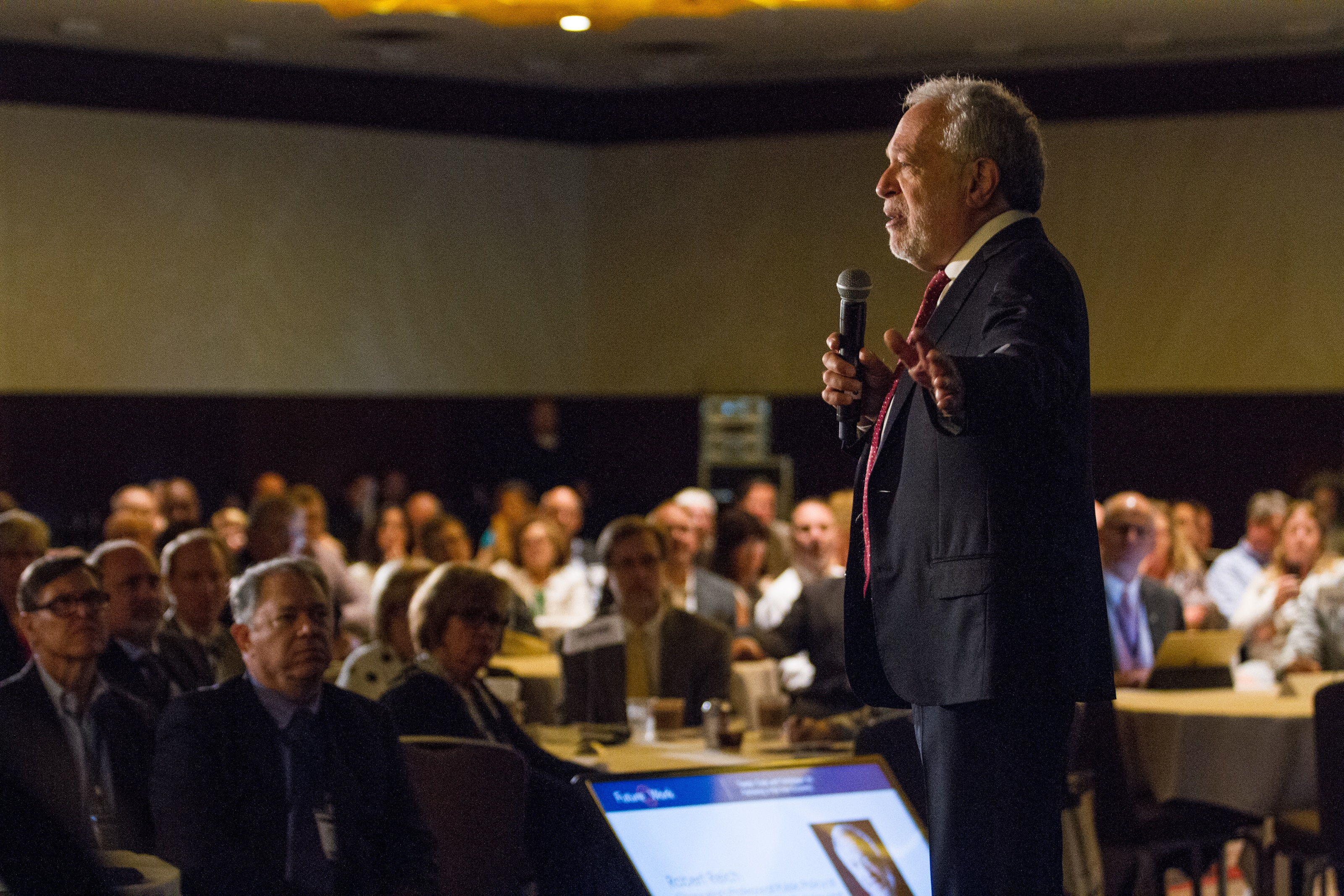Robert Reich speaking at a conference