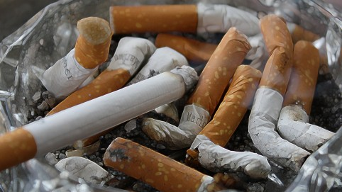 A bunch of cigarette butts in an ashtray