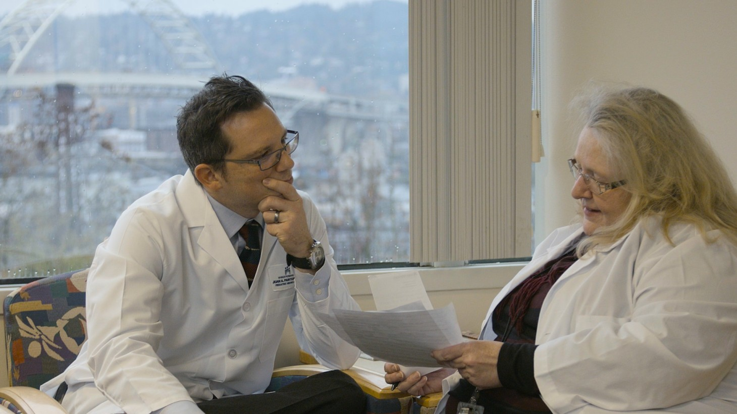 Doctor discussing a case with another health care worker
