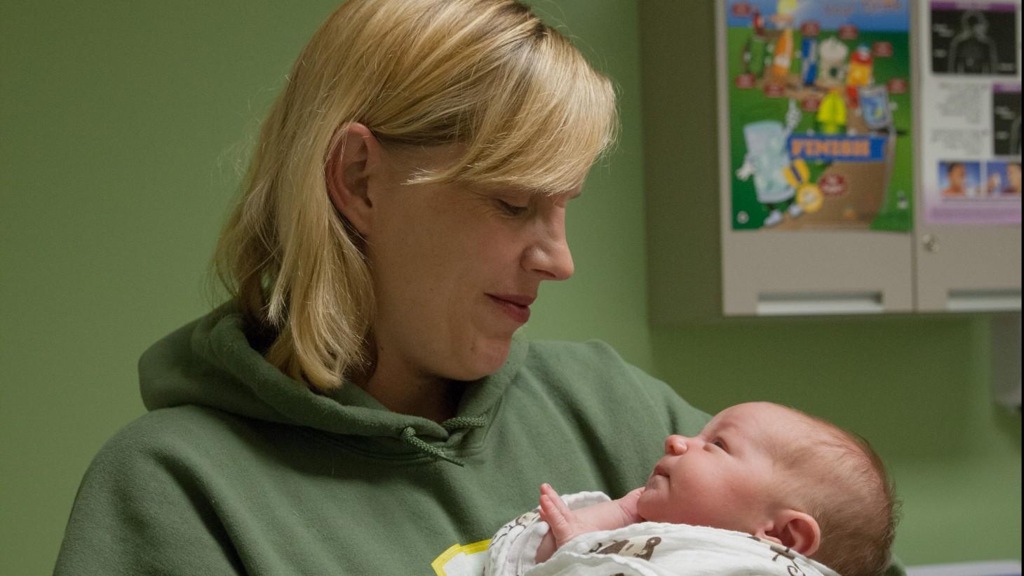 """alt=""""A new mom holds a newborn."""""""
