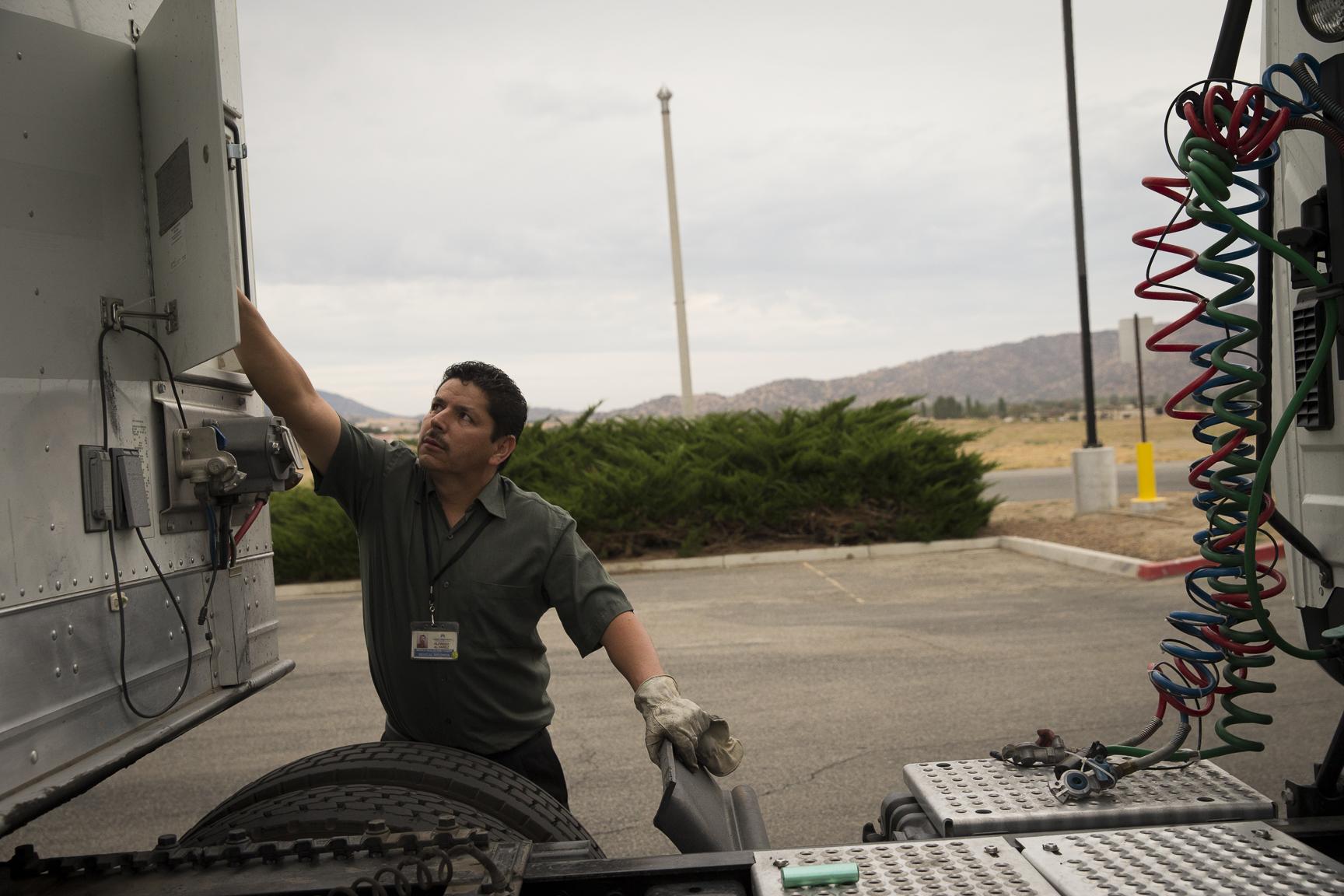 """alt=""""Driver prepares his truck."""""""