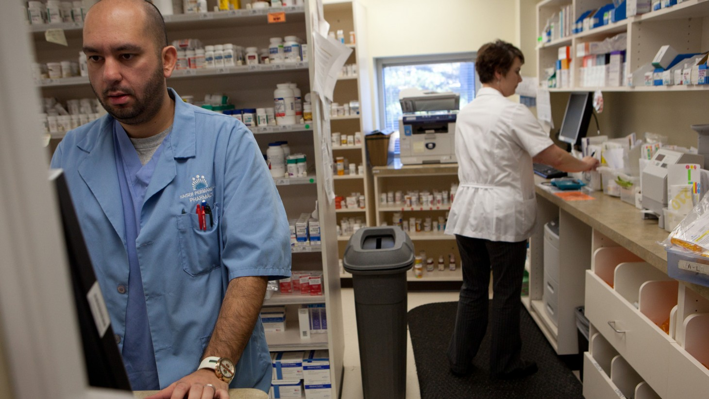 Two workers in a pharmacy