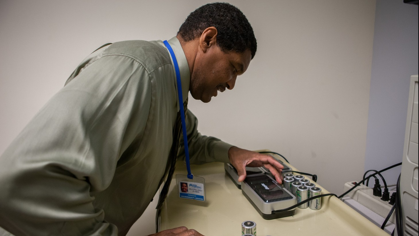man with battery recycling device