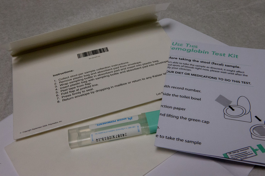 Envelope, test tube and instructions for a FIT kit
