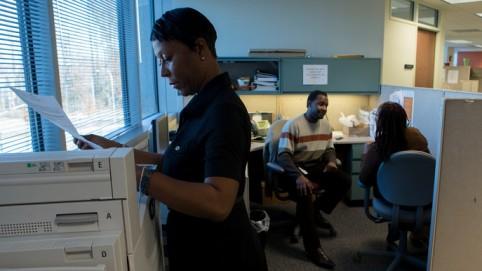 Monisha Frye, woman at a printer