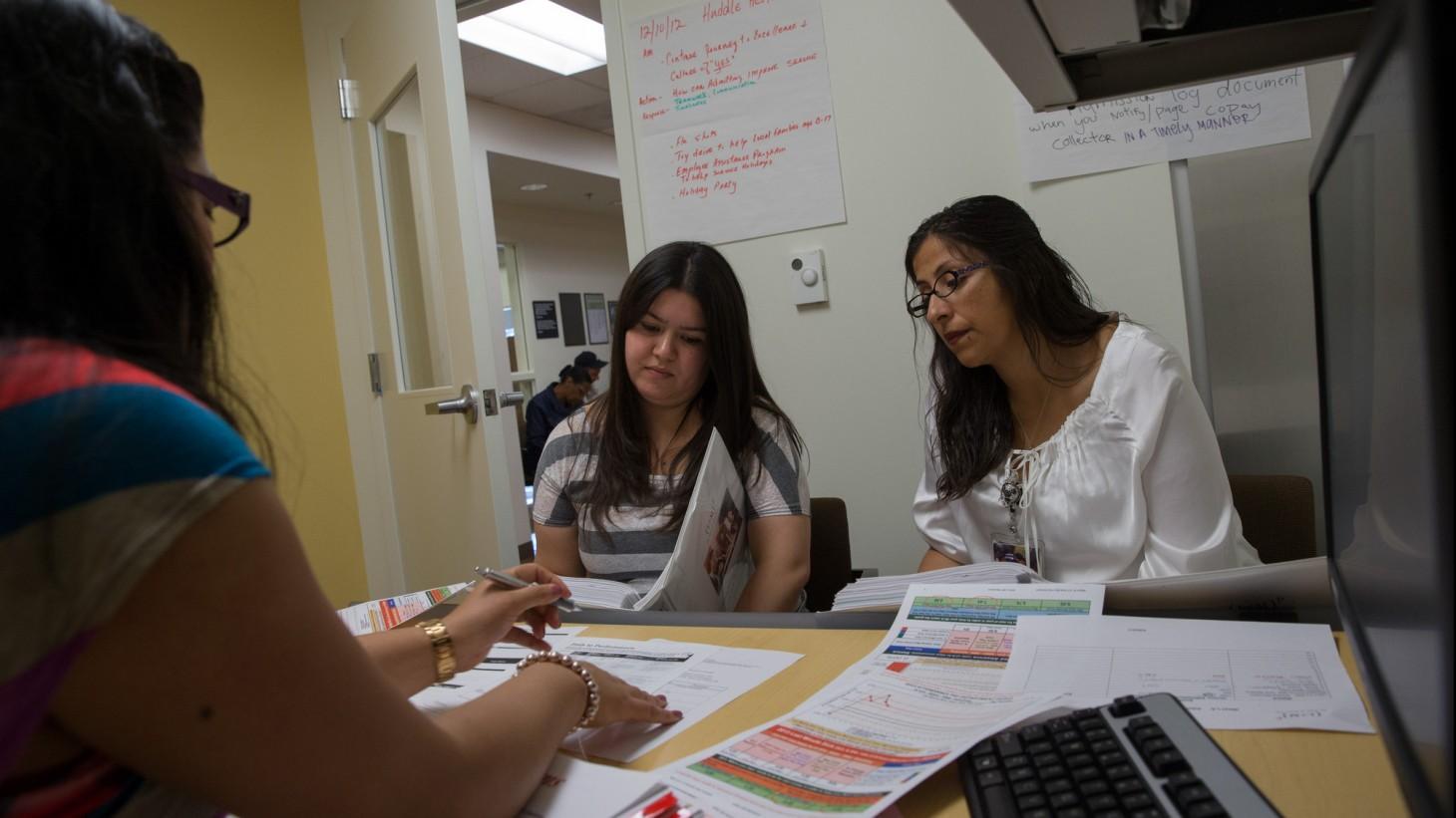 three women meeting around a desk