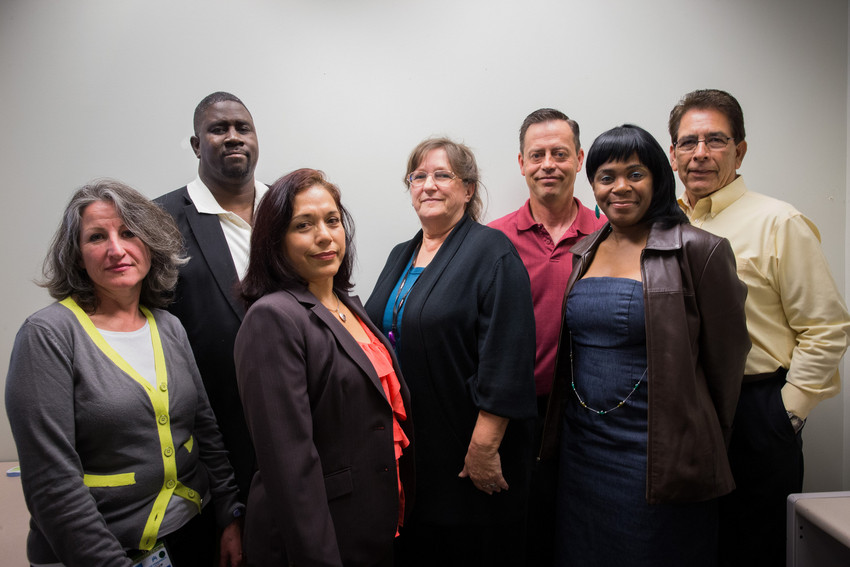 Charitable Health Coverage. L-R: Bilingual Enrollment Processor Miriam Garcia, OPEIU LU 29; Enrollment Processor/Union Steward Carl Artis, OPEIU LU 29; Enrollment Processor Arsenia Alonso, OPEIU LU 29; Systems Manager Susan Davis, Management; Systems Administrator William Bilbrey, Management; Enrollment Processor Sharlene Jone, OPEIU LU 29; National Operations Manager Maurice Rosas, Management.