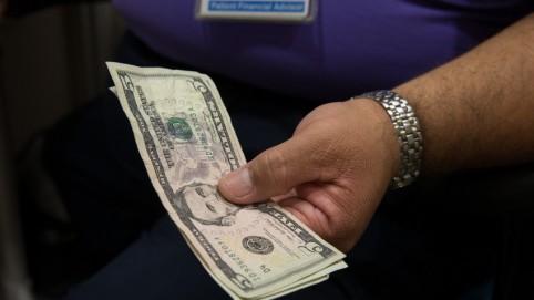 Man's hands holding cash