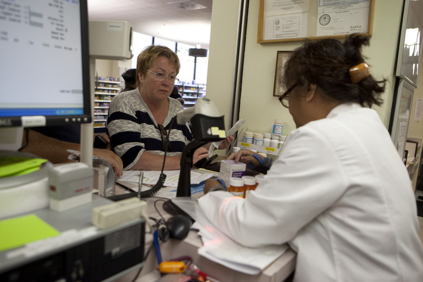 Pharmacy tech speaks with patient.