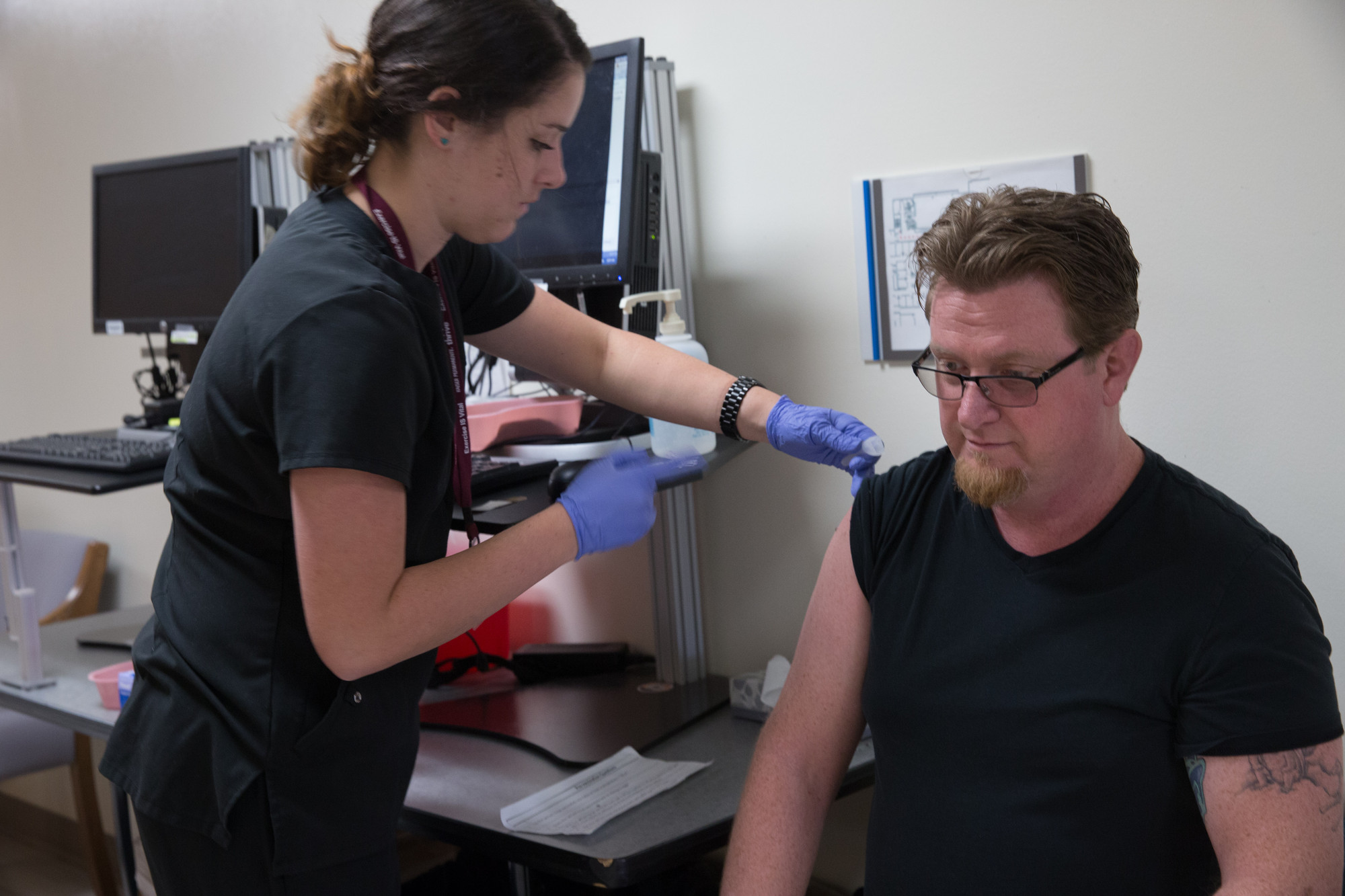 Nurse gives flu shot.