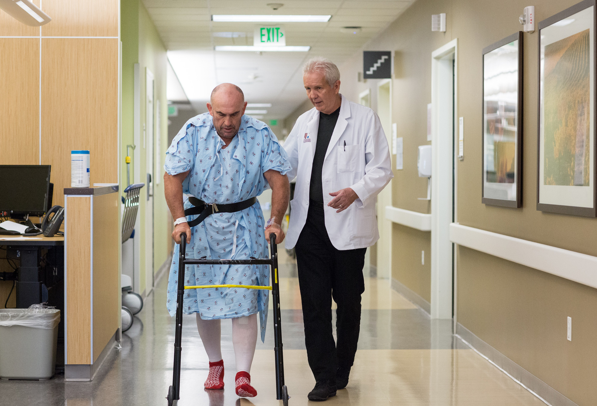 Doctor and elderly patient with walker.