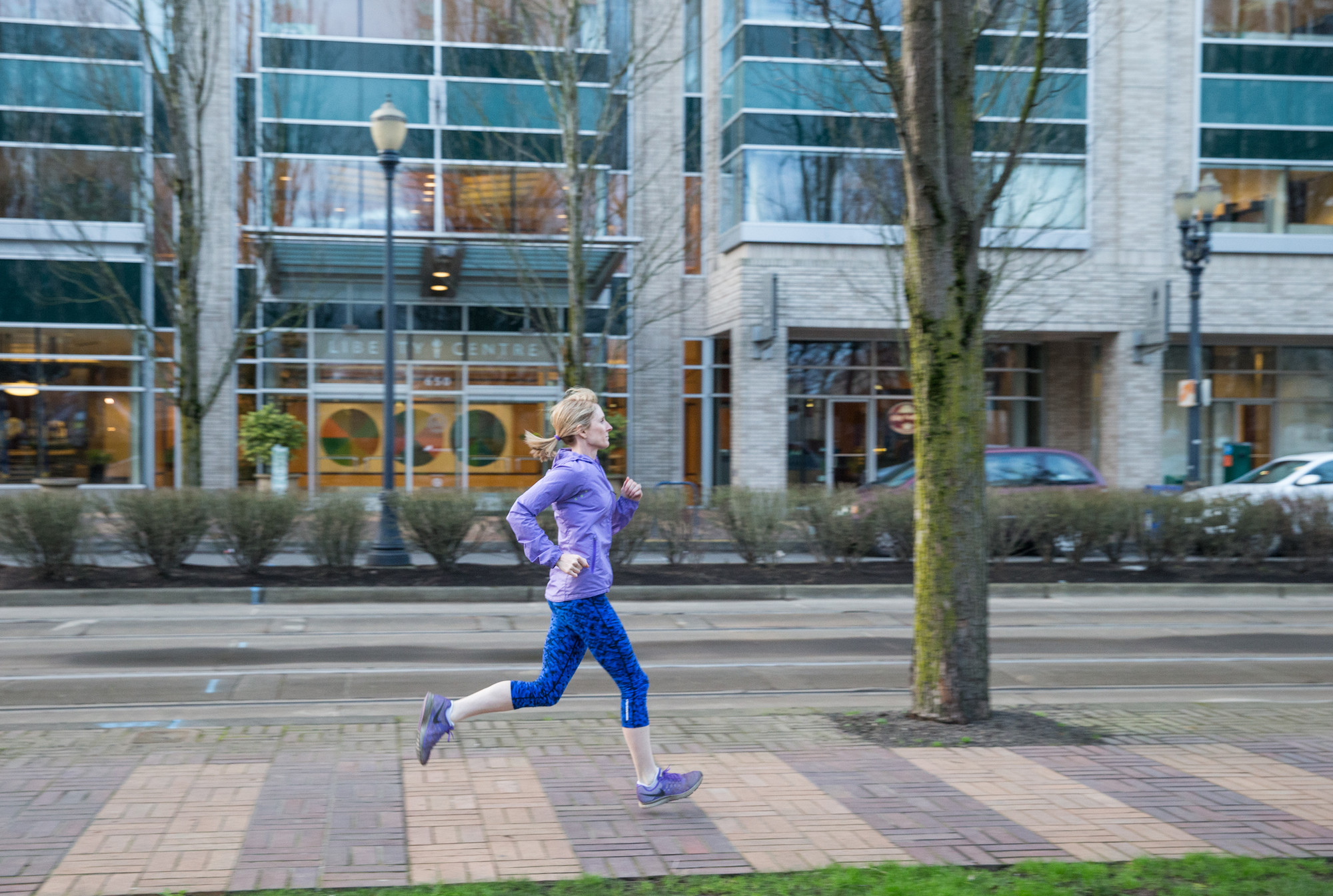 Woman jogging on a city sidewalk
