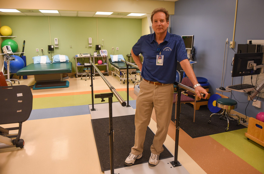 Man standing in a rehab gym