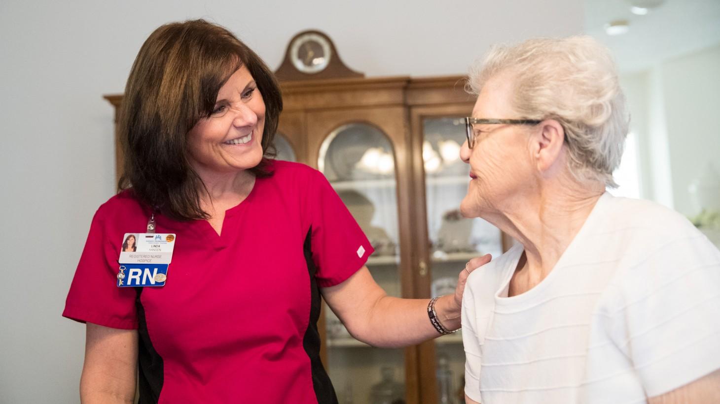 Linda Hansen, a nurse, standing with her patient, Madeline Lanell Haxton