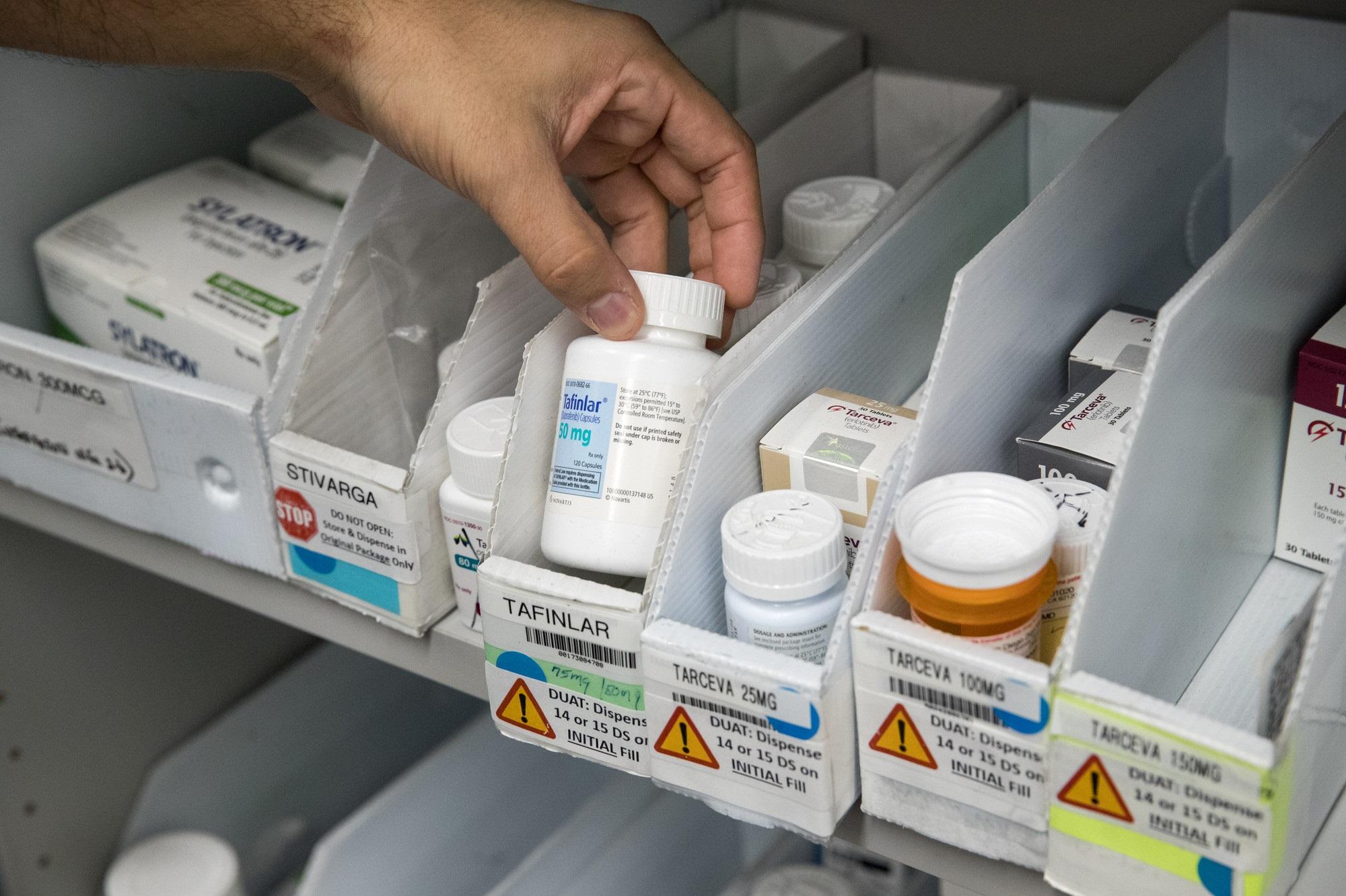 medication on a pharmacy shelf
