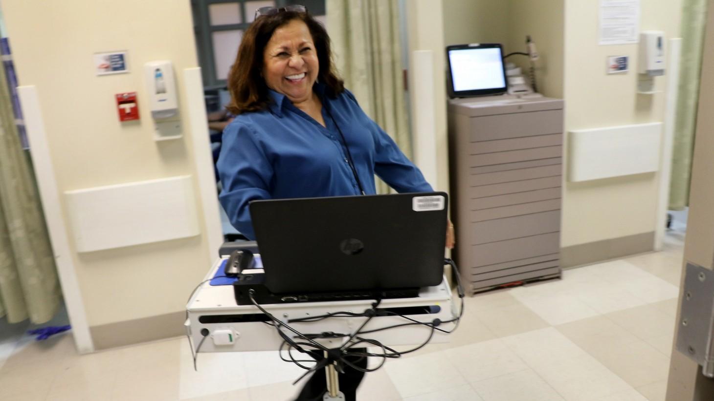 Ninneth O'Hara, with laptop on wheels.