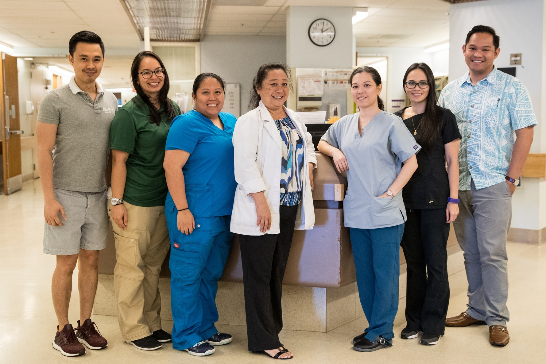 group of health care workers posing at a hospital nurses' station