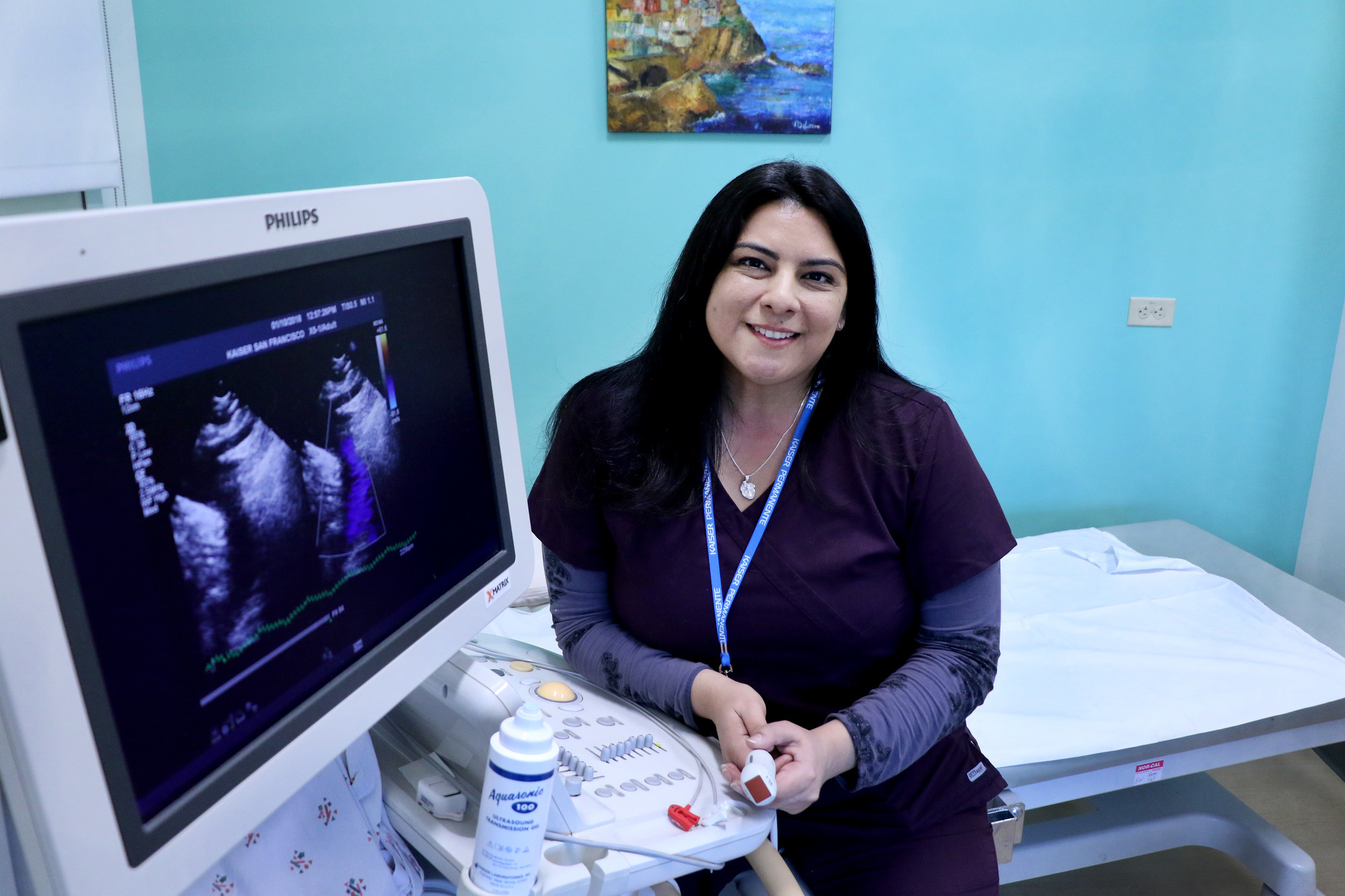 Portrait of sonographer sitting next to her equipment