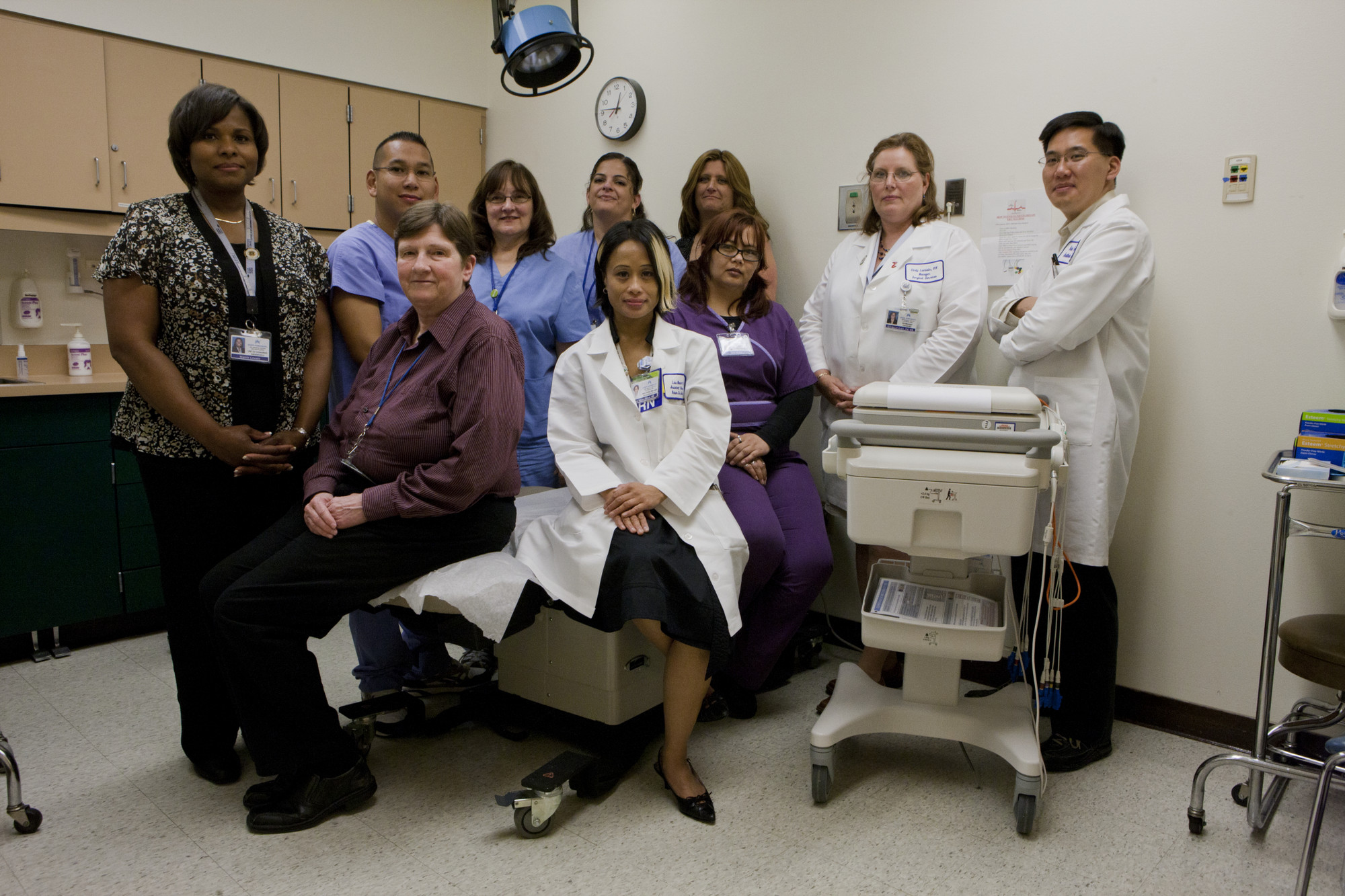a group of health care providers posing in a hospital room