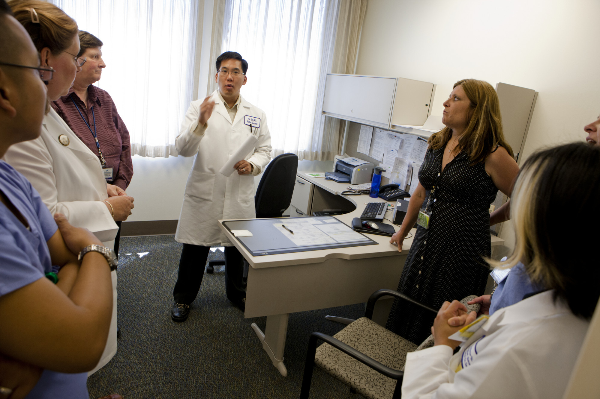 Doctor and health care workers in an office