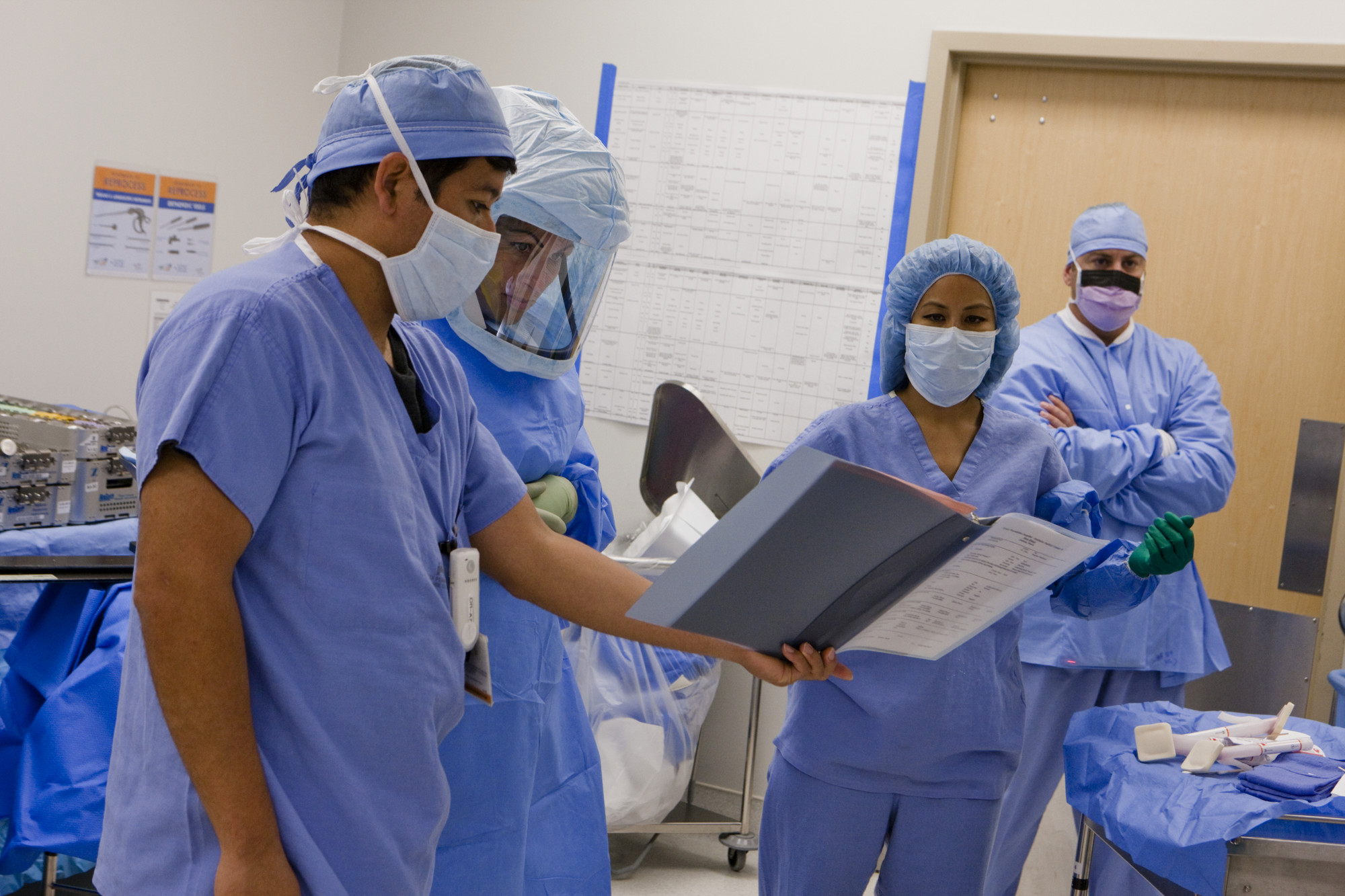 A team of surgeons gets ready to operate