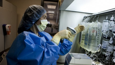 Nurse checks IV medications.