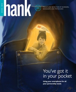Magazine cover featuring a cell phone in a person's pocket