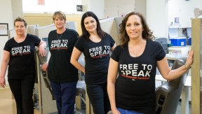4 women wearing black Free to Speak t-shirts
