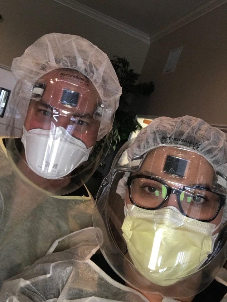 two female health care workers wearing protective gear