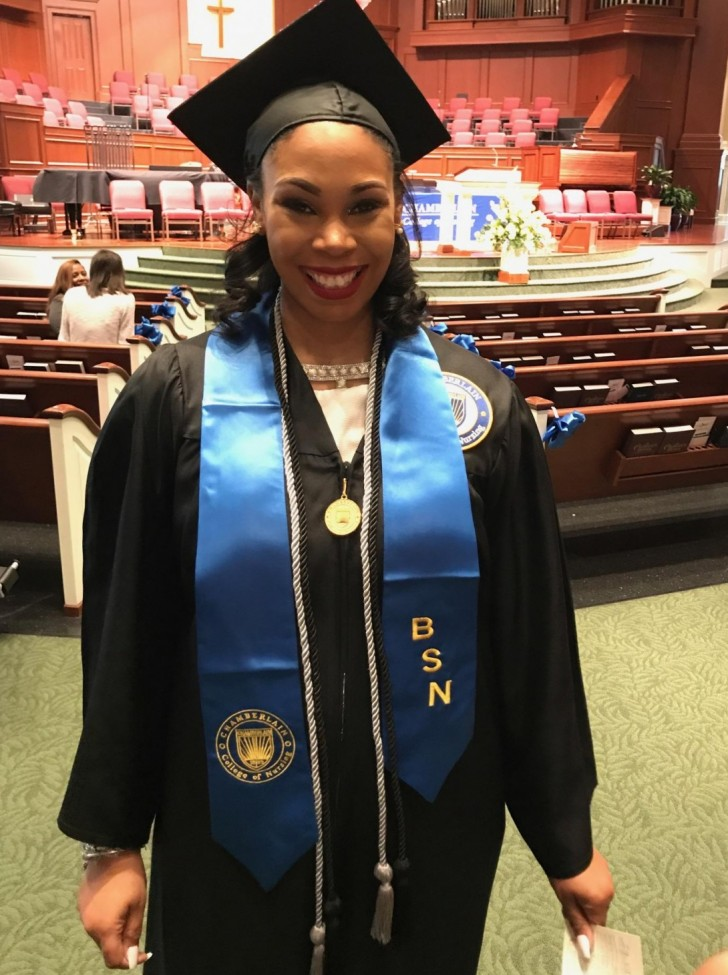 Janiece wearing her graduation gown and sash