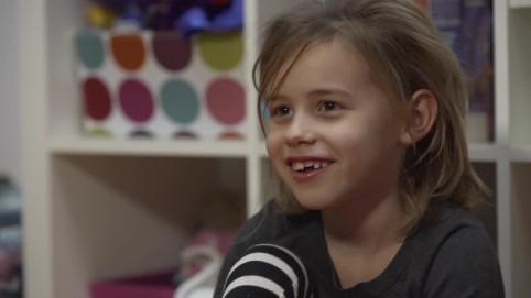 A cute little blonde girl smiling