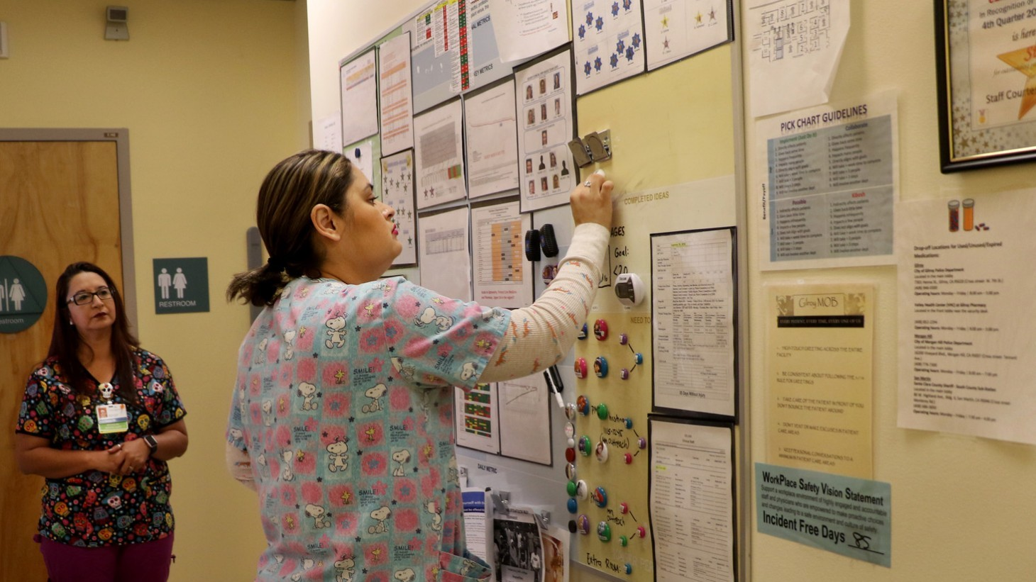 A team member records data on a visual board